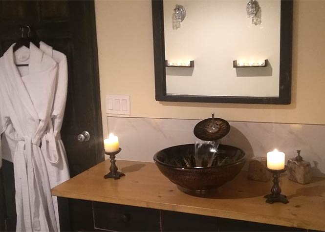 The Sunset B&B Suite: Hand crafted vanity with a wallfall faucet